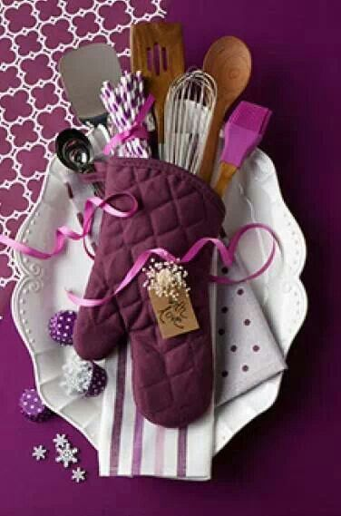 cooking/baking tools in an oven mitt on a pretty plate.