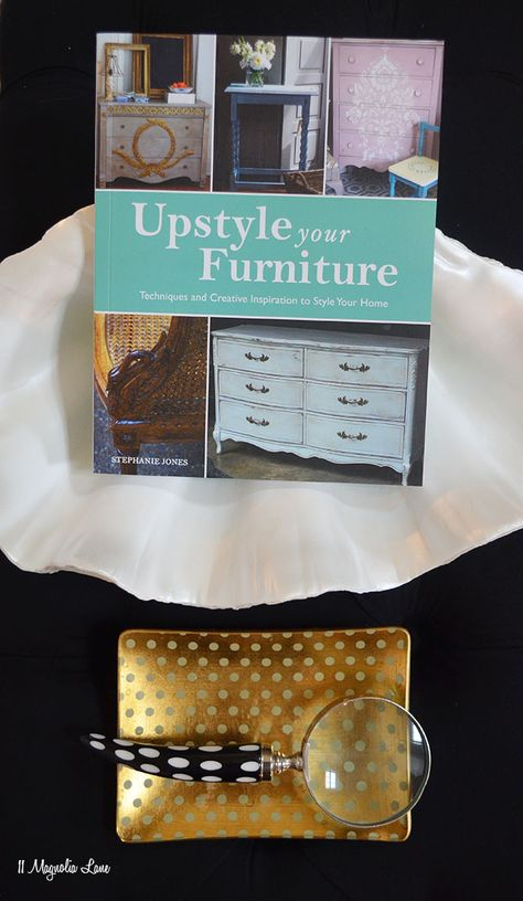 Upstyle Your Furniture:  Techniques and Creative Inspiration to Style Your Home by Stephanie Jones; features 11 Magnolia Lane's white painted dining room set (white chalk paint, clear and dark wax, distressing, canvas drop cloth reupholstery, and monogramming using the CitraSolv fabric transfer technique)