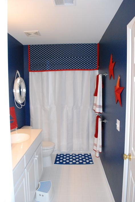 For the boys bathroom - perhaps change out the nautical for sports theme? I like the color and can reuse my white curtain...