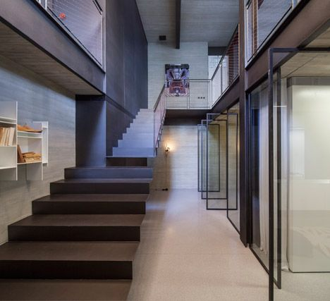 A Tel Aviv flat that was once the home of Israel's first prime minster David Ben-Gurion has been renovated and extended to create a new basement level with industrial-style fittings.