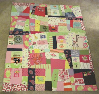 quilt made of  baby clothes:)  how i wish i could sew...the woman who made this is so very talented!!