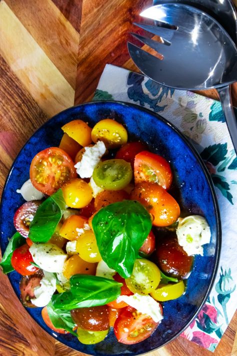 Sweet, juicy tomatoes paired with rich, creamy mozzarella - this one's always a winner for lunch or dinner. #healthysalad #capresesalad #tomatosalad #mozzarellasalad #saladrecipes