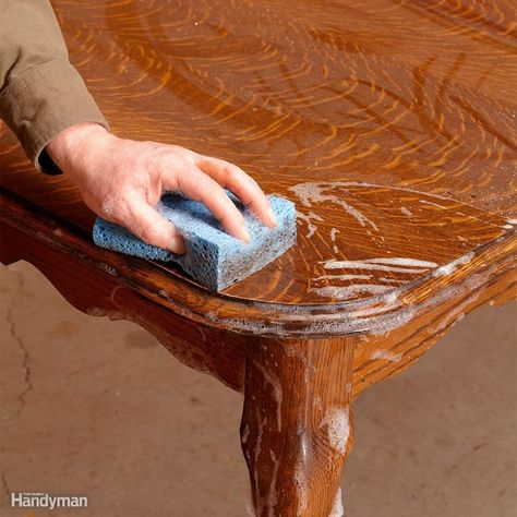 A thorough cleaning is an important first step in any furniture renewal project. Removing decades of dirt and grime often restores much of the original luster. Kevin says it's hard to believe, but it's perfectly OK to wash furniture with soap and water. Kevin recommends liquid Ivory dish soap mixed with water. Mix in the same proportion you would to wash dishes. Dip a sponge into the solution, wring it out, and use it to gently scrub the surface. A paintbrush works great for cleaning carvings...