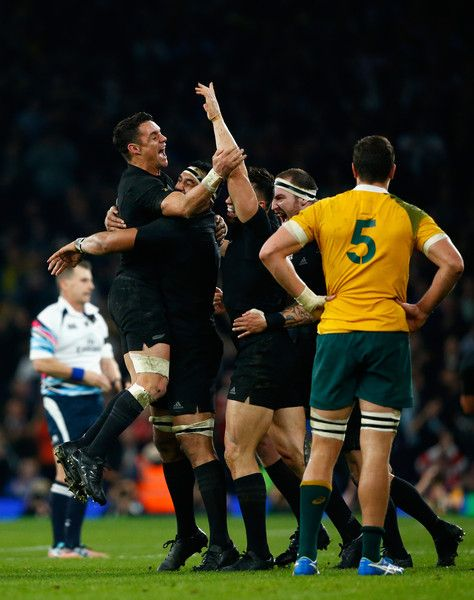 Dan Carter (l) and New Zealand team mates celebrate on the final whistle after the 2015 Rugby World Cup Final match between New Zealand and Australia at Twickenham Stadium on October 2015 in London, United Kingdom.