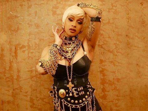 Cardi b recreated a 1995 chanel look worn by linda evangelista