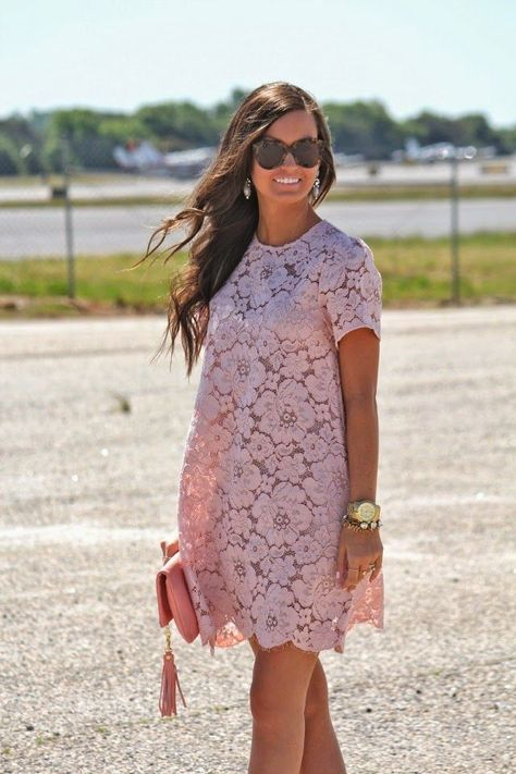 Shop this look on Lookastic:  http://lookastic.com/women/looks/shift-dress-watch-bracelet-clutch-sunglasses/10661  — Pink Lace Shift Dress  — Gold Watch  — Gold Bracelet  — Pink Leather Clutch  — Dark Brown Sunglasses