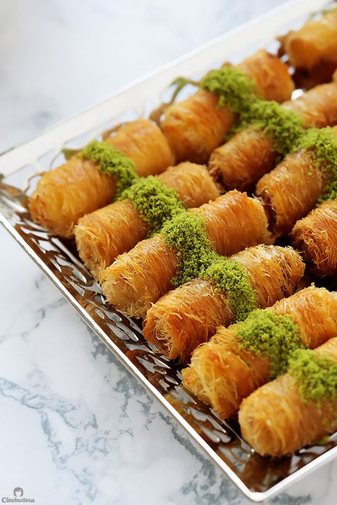 Ricotta Kunafa Rolls, Creamy ricotta cheese wrapped inside golden, crunchy strands of sticky sweet kunafa. A sprinkling of vibrantly green pistachios add the finishing touch to this handheld delicacy. Lebanese Desserts, Lebanese Recipes, Greek Recipes, Indian Food Recipes, Lebanese Baklava Recipe, Turkish Dessert Recipes, Lebanese Cuisine, Arabic Dessert, Arabic Sweets