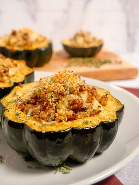 This stuffed acorn squash screams fall! Roasted acorn squash stuffed with Italian sausage, apples, sage, and topped with crunchy parmesan panko! #squash #acornsquash #roastedsquash #stuffedsquash #fallrecipe #sausage #sage #stuffing #apples