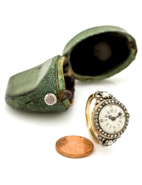 PIERRE MORAND - AN ANTIQUE RING WATCH, CIRCA 1785. ONE OF THE SMALLEST MOVEMENTS KNOWN MADE IN THE 18 CENTURY. Very fine and extremely rare, 18K gold ring watch set with diamonds.