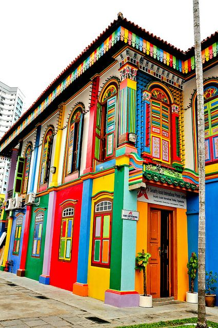 """This beautiful colorful building is located in little India, Singapore. The architecture is very vintage looking, however the colours do give a modern and """"summery"""" vibe. These summer colours go well with Singapore's hot weather. Colourful Buildings, Beautiful Buildings, Beautiful Places, Colorful Houses, Unusual Buildings, Beautiful Streets, Amazing Places, Little India Singapore, Singapore Travel"""