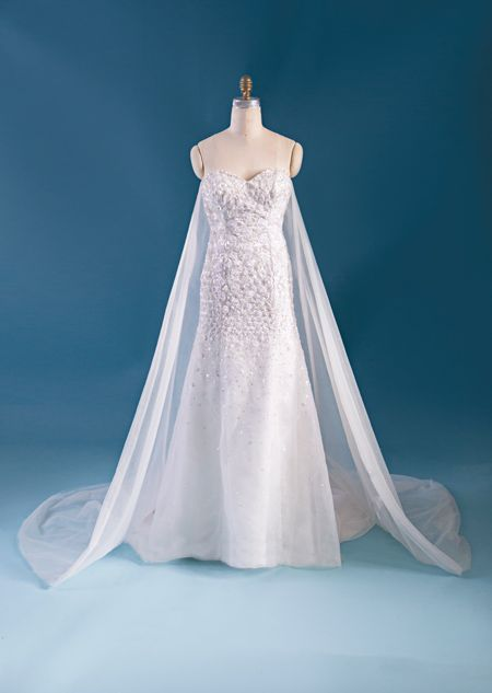A woman wearing the Belle wedding gown from the Alfred Angelo Bridal ...