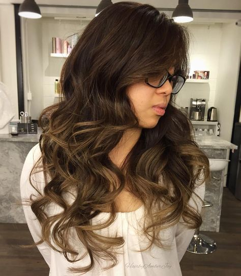 Sophisticated Subtle Brown Balayage Lob The raven black roots complemented by a balayage blend of dark chocolate hair is a statement within itself, but an angled lob cut with tousled mid-shaft waves adds even more interest.