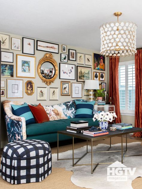 This gallery wall, filled with gold, silver and black frames, takes up the entire wall of an eclectic maximalist style living room. See more on HGTV.com.