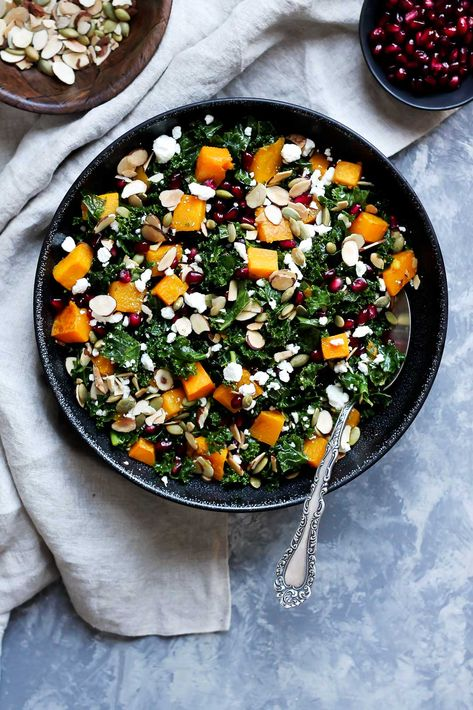 Healthy butternut squash and kale salad with pomegranate, goat cheese and almonds! A great salad during the holiday season. Easy to make and SO delicious! #butternutsquash #kalesalad #healthysalad #healthylunch