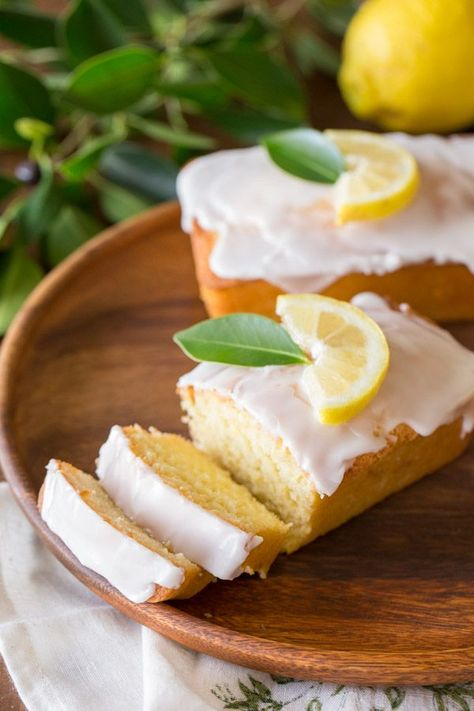 Mini Iced Lemon Pound Cake Loaves - sweet and moist with just the right amount of lemon flavor. Made healthier with coconut oil and Greek yogurt! #lemonpoundcake #minicakeloaves #breakfast #dessert #lemonflavored #poundcake