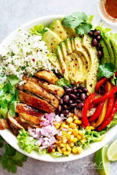 Fajita Chicken Burrito Bowl is packed with juicy golden chicken, cilantro lime rice, avocado and a delicious dressing! Perfect for meal prep!   cafedelites.com #healthyfood