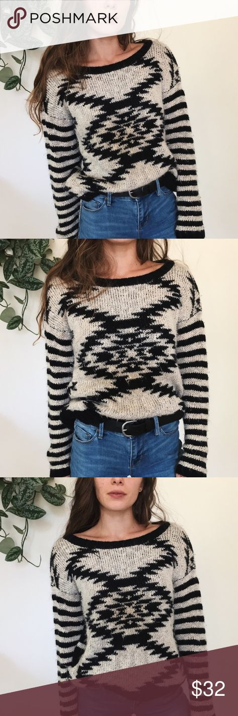 Cozy retro sweater Cozy black and white retro sweater. Gently used but no flaws, just a bit fuzzy. Perfect for fall. Takara Sweaters