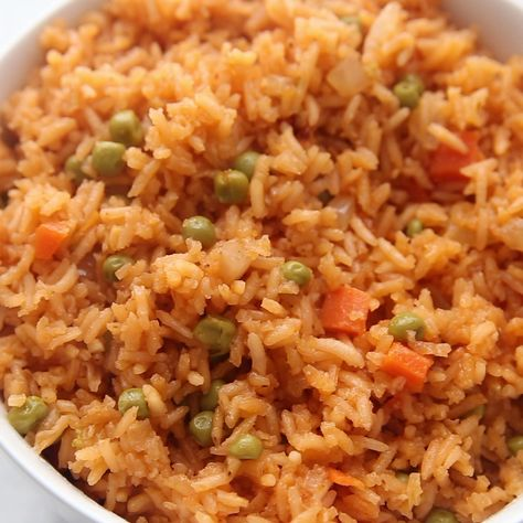 The BEST, truly authentic Mexican rice is an easy recipe to make for a crowd and it's a necessary side dish for all of your favorite Mexican recipes.
