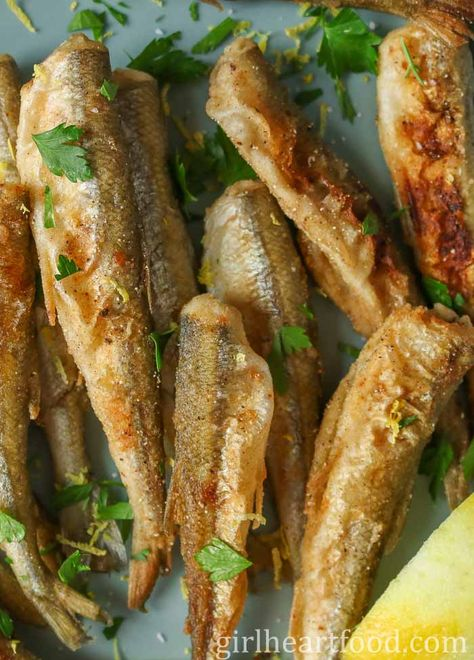 Fried smelt are such an easy a delicious recipe that can be enjoyed as an appetizer or main with a side. Smelt are lightly coated in a seasoned flour mixture and gently fried in a cast iron skillet. #friedsmelt #smeltfishrecipe #crispysmelt #panfriedsmelt #breadedsmelt #smeltrecipe #smeltfish #seafoodrecipe #fishrecipe