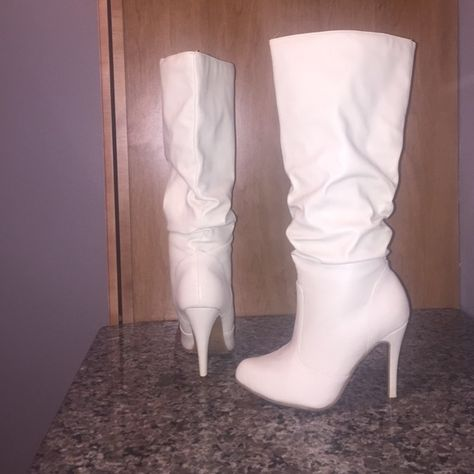 Cream Heeled Boots Only worn once! Four inch heel boots with a slouch look. Really cute and has a retro look to them. Hits a little under the knee. Amazing condition. Shoe Dazzle Shoes Heeled Boots