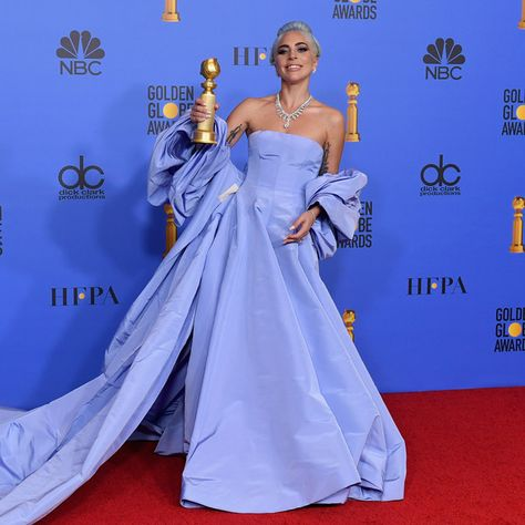 Lady Gaga poses with the trophy in the press room during the 76th Annual Golden Globe Awards at The Beverly Hilton Hotel.
