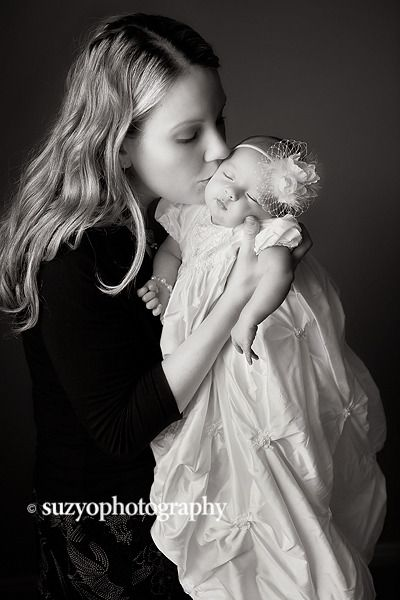 Love the idea of taking a photo with baby in her christening gown! Kind of want to put her dress back on for this shot!!