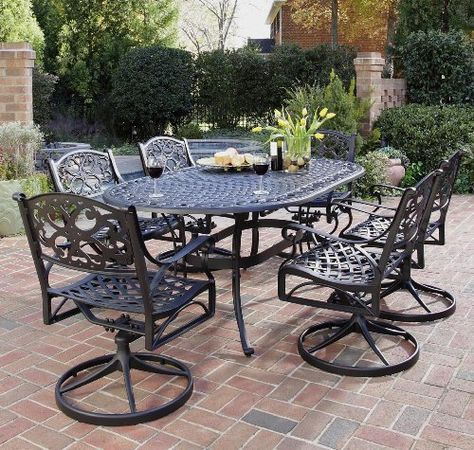 Table And Six Swivel Arm Chairs