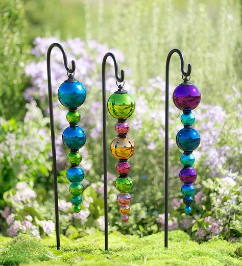 2 in 1 Colorful Glass Finial Ornaments, Set of 2 | Decorative Garden Accents | These gorgeous glass finials can hang from their shepherd's hooks in a flower bed or along a path, or you can showcase them in a planter with their stake.