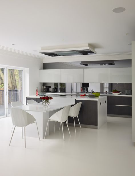 Family kitchen contemporary design, white and modern by Neil Lerner design and fit service london