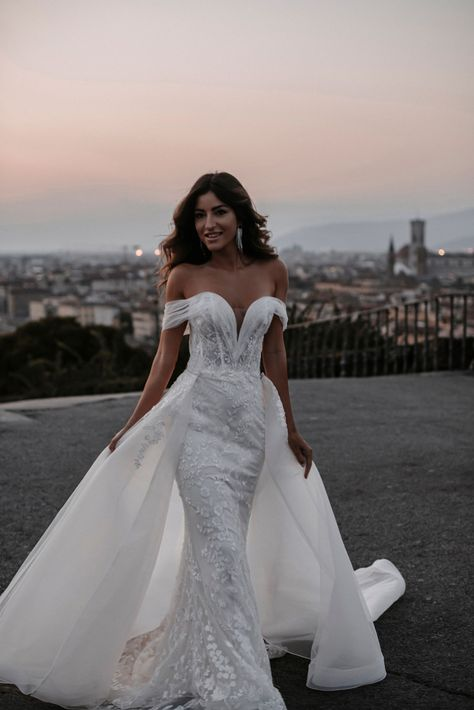 With the added train or as a stand-alone silhouette, the Abella collection gives brides timeless gowns with beadwork to match. Each gown in the collection was designed with the bride's beauty and uniqueness in mind. Available for brides size 0-30. Shop the debut collection. #europeanstylewedding #europeanstylegown #europeaninspired #timelessbride #oldmeetsnew #inspiredbytheroyals #moderndaybride #weddinginspo #chicwedding #princessweddingdress #dressinspiration