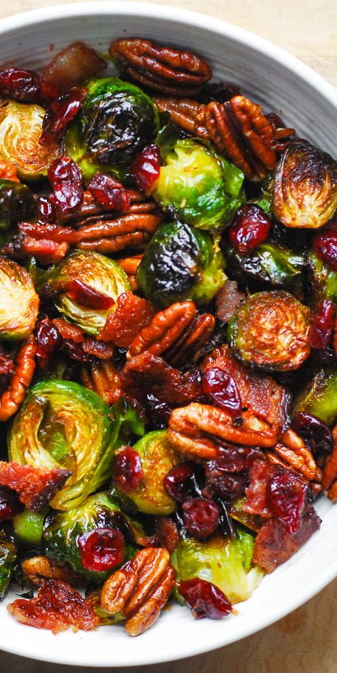 Roasted Brussels Sprouts with Bacon, Toasted Pecans, and Dried Cranberries is an easy Christmas side dish that will add colors and vibrancy to your holiday menu! #brusselssprouts #bacon #Christmas #Christmasrecipe #side #sidedish