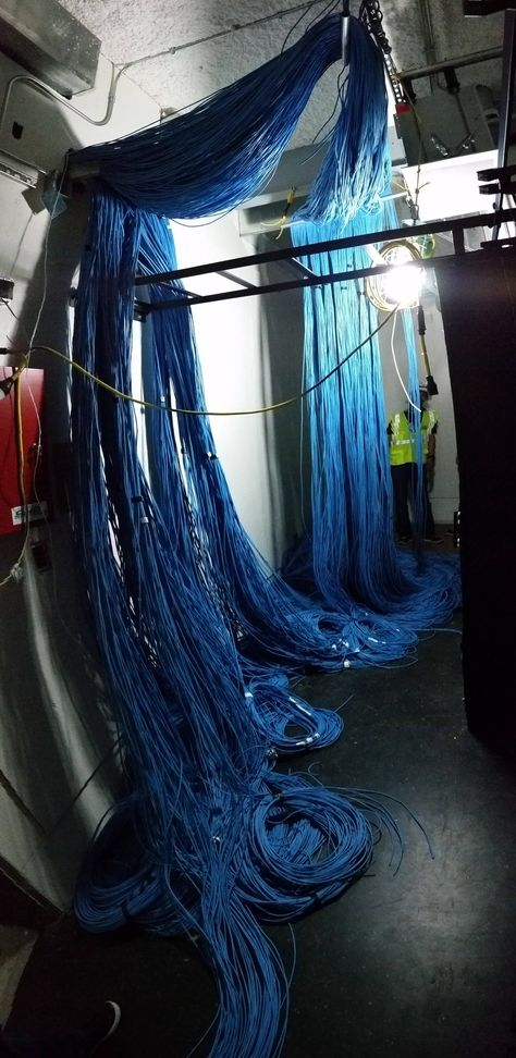 Cat 6 Ethernet wire waterfall. That is a lot of future data lines.