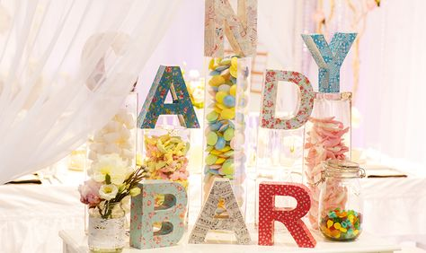 Yum! A candy bar at the reception! http://www.countryoutfitter.com/style/fun-wedding-reception/?lhb=style