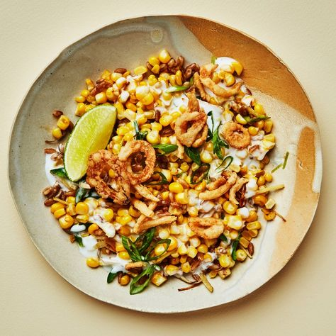 Turmeric, chiles, and chewy-nutty cooked grains balance the sweetness of fresh corn in this loose vegan riff on creamed corn.