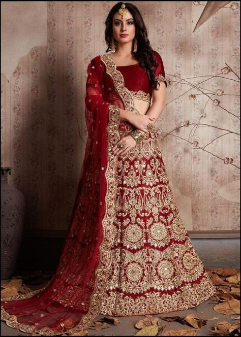 Dazzle on your special day and look beautiful wearing this flared heavy embroidery bridal maroon lehenga in velvet designed with heavy zari and dori golden embroidery work all over enhanced by sparkly stone, beads and mirror embellishment. Dimension: Lehenga: 44 inches, Choli: 0.8 mts, Dupatta: 2.5mts. Work: Embroidered, Mirror Work, Beads Work, Lace. Color: Lehenga: Maroon, Choli: Maroon, Dupatta: Maroon. Fabric: Lehenga: Velvet, Choli: Velvet, Dupatta: Net. Occasion: Bridal, Wedding, Festival. Bridal Lehenga Online, Bridal Lehenga Choli, Lehenga Choli Online, Golden Bridal Lehenga, Sabyasachi Wedding Lehenga, Red Wedding Lehenga, Pakistani Lehenga, Anarkali Churidar, Designer Bridal Lehenga