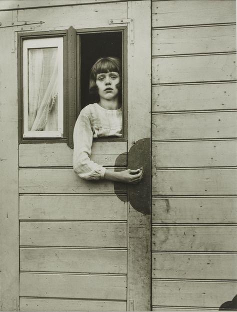 Girl in Fairground Caravan by German photographer August Sander.