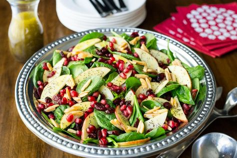 An insanely delicious and super healthy salad - perfect for any get together with family and friends! #spinachsalad, #applespinachsalad, #bestspinachsalad, #easyspinachsalad