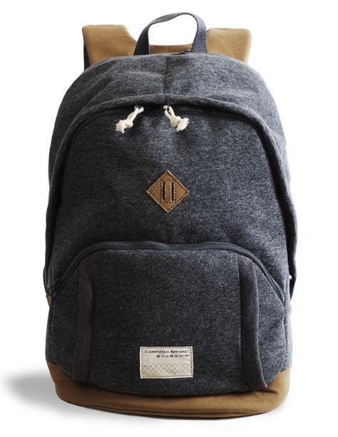 this sweatshirt-y laptop backpack comes with a hidden elastic waterproof rain hood. so smart!