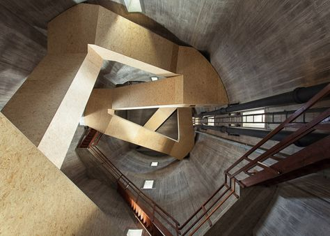 A national park in the Netherlands is the setting for this old water tower, which Dutch firm Zecc Architecten transformed into an observation point by twisting staircases through its middle.