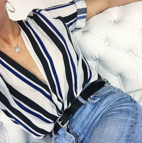Stripes are still here and better than ever. Tuck into belted denim to keep it très chic.