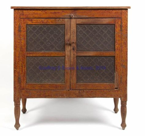 """RARE AUGUSTA CO., SHENANDOAH VALLEY OF VIRGINIA PAINT-DECORATED PUNCHED-TIN-PANELED YELLOW PINE FOOD / PIE SAFE, the rectangular two-board top over two hinged doors, raised on tall, finely turned, inverted-baluster-form feet. Doors and sides each set with two punched-tin panels in diapered-diamond pattern. Original paint-decorated surface. Mid 19th century. 43"""" H, 41 1/2"""" W, 19"""" D."""
