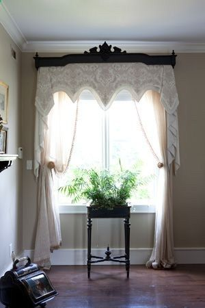 beautiful wood cornice with fabric valance and drapes window