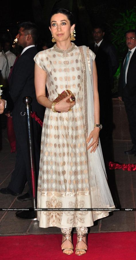 Karisma Kapoor at #ArpitaKhanReception in cream & gold #Anarkali, Gold Jhumkis, via @moviesNDTV