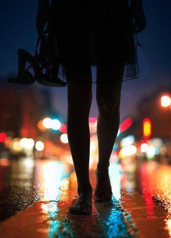 Barefoot woman walking on street at night,/Haruki Murakami After Dark Photo by Piotr Powietrzynski