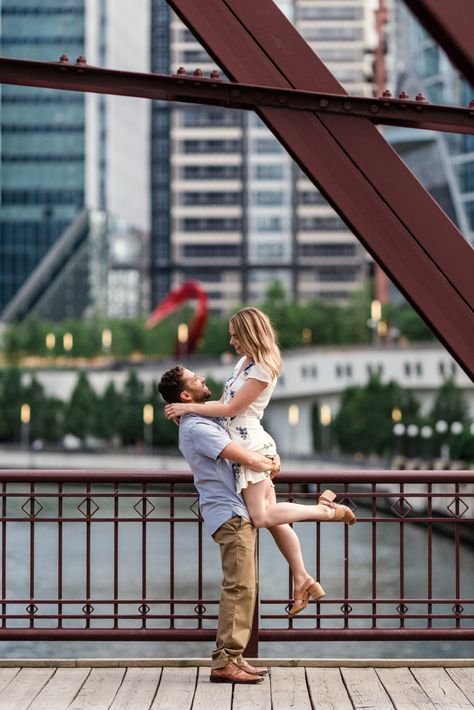 Groom picks up bride on Kinzie Bridge during summer Chicago engagement session