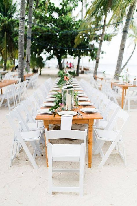 Didn't know wooden tables and white Hercules chairs look good together. <3 Photo: Helium Hearts by Marlon Capuyan Tables & Chairs: T&C Rental and Event Services #wedding #weddingsph #cebuweddings #philippineweddings #bride #bridesph #couple #groom #groomsph #styling #flowers #flowerstyling #cebuweddingstylist #firstofapril #FOAreception #weddingtablesetup #outdoorwedding #beachweddingreception #outdoorreception