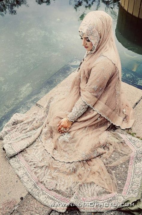 The perfect angle.  And the water makes this pose so pretty #PerfectMuslimWedding.com