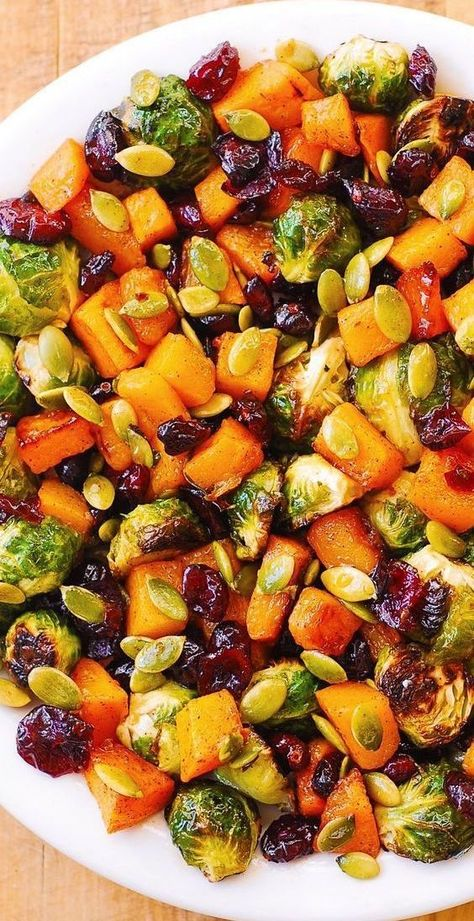 Brussels Sprouts with Maple Butternut Squash, Pumpkin Seeds, and Cranberries #holidays #holidaysalad #butternutsquash #brusselssprouts
