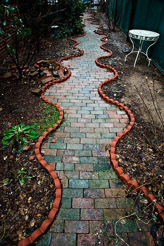 Whimsical garden pathway in historic Bay Ridge Brooklyn home. | Photo: Randy Harris for the New York Times