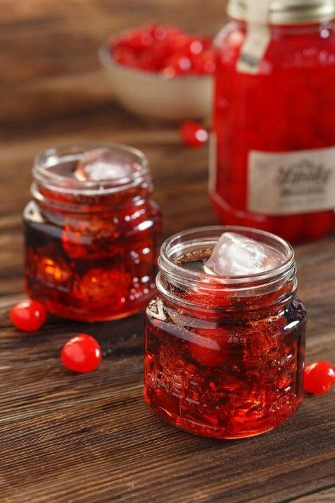 Ol Smoky cherry moonshine pop | Simply mix equal parts juice from Ole Smoky's Moonshine Cherries and Cola. Add a few moonshine cherries for good measure. Pass the jar and shine responsibly!